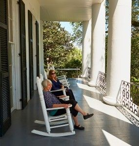 The girls relax on the Dunleith porch.