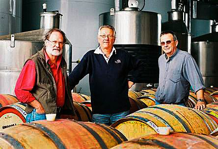 Norm Doole one of the main drivers  of Connors Farm in the center, with Dowie Doole founders, Drew Dowie and Leigh Gilligan. Photo : Dowie Doole Wines.