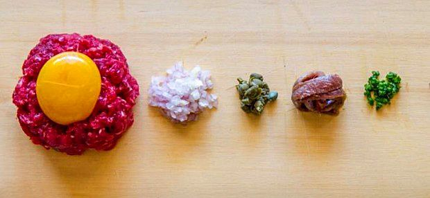 Steak tartare and accompanying ingredients from the book ' Tongue and Cheek' : Photo © David Reist.