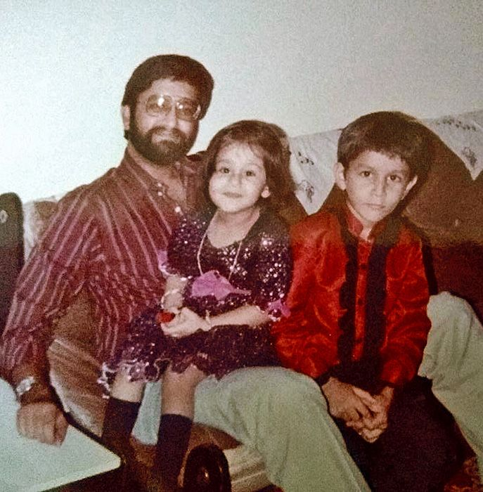A young Bhatia with Dad and  younger sister.